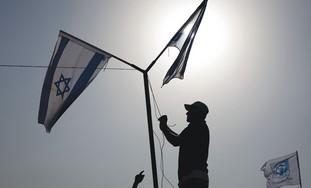 IsraeliFlagsBeingRaised