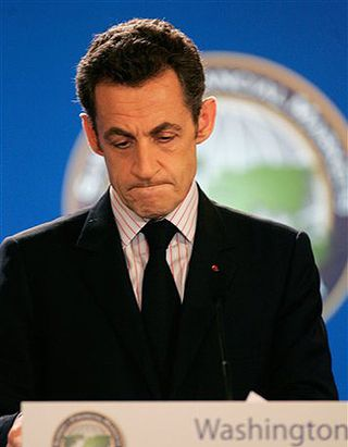 SarkozyLookingDownward