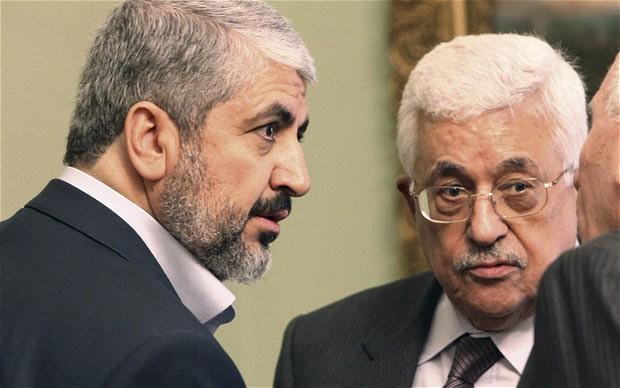 HamasLeaderKhaledMeshaal(L)&PalestinianPresidentMahmoudAbbasAtMeetingInCairoReuters
