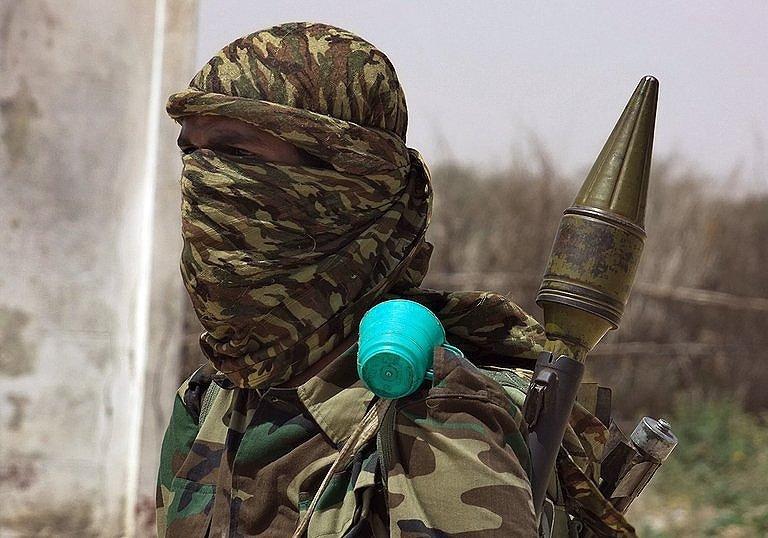 IslamistFighterLoyalToSomaliasAl-QaidaInspiredal-ShebabGroupHoldsHisArms